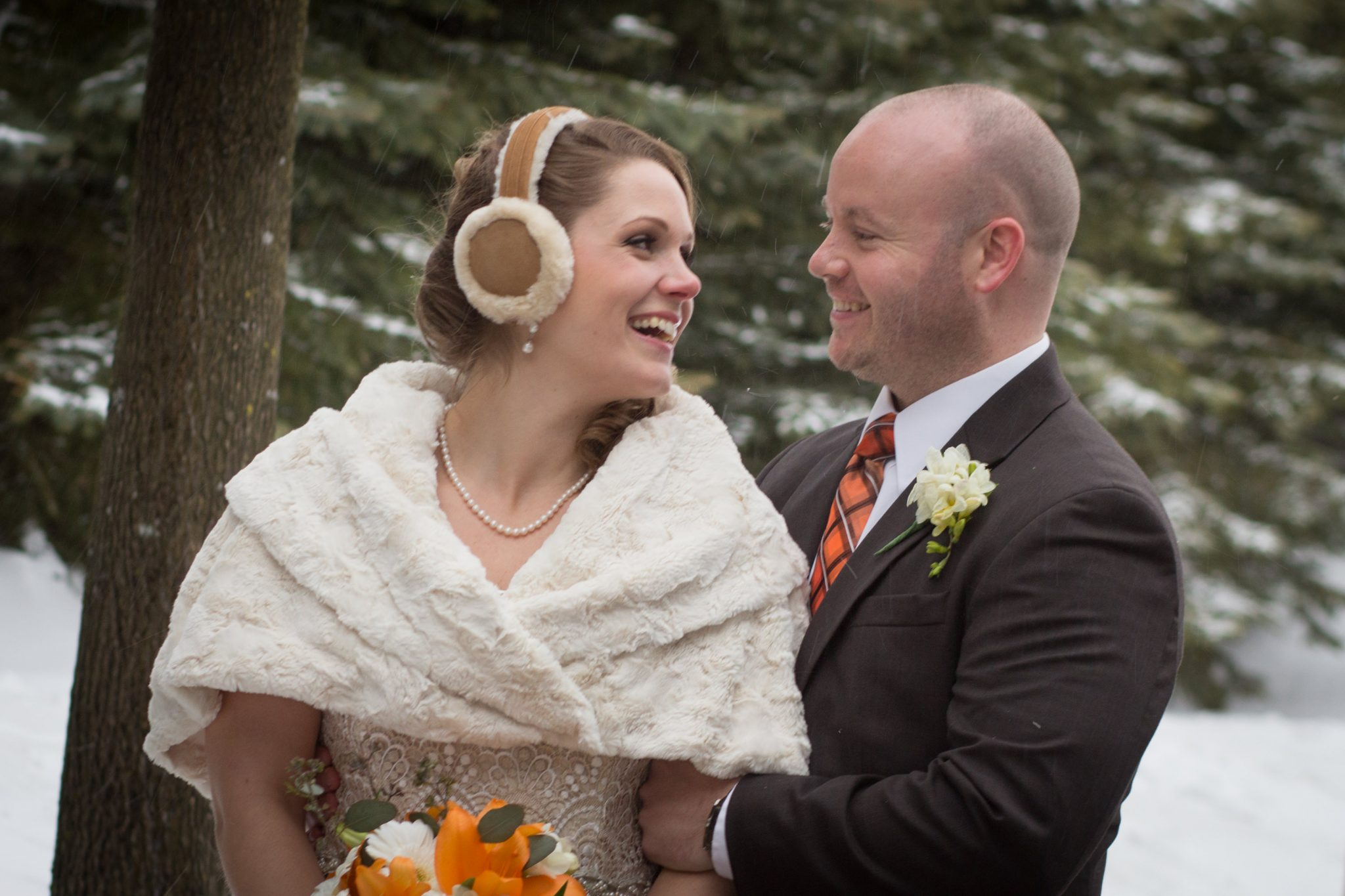 Winter wedding couple candidly laughs at Killington in Vermont