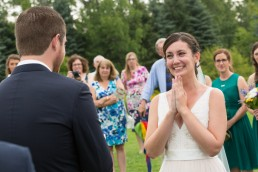 Excited bride at the Catamount Outdoor club in Vermont