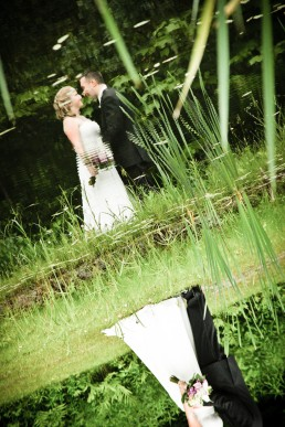 a reflection of couple in pond at Sleepy Hollow in Vermont