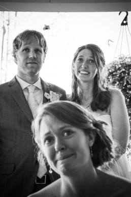 Emotional image of toast reactions in black and white by Vermont wedding photographers