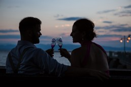 champagne cheers on lake champlain vermont engagement portraits