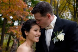 Fall wedding portrait of couple, close up of Asian bride by Vermont wedding photographers