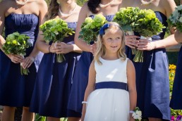flower girl looks up in awe of bride at Jay Peak in Vermont
