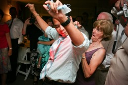 garter dance candid wedding reception photograph by Vermont wedding photograpers