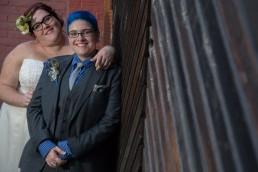 portrait of gay wedding couple featuring blue in Burlington, Vermont