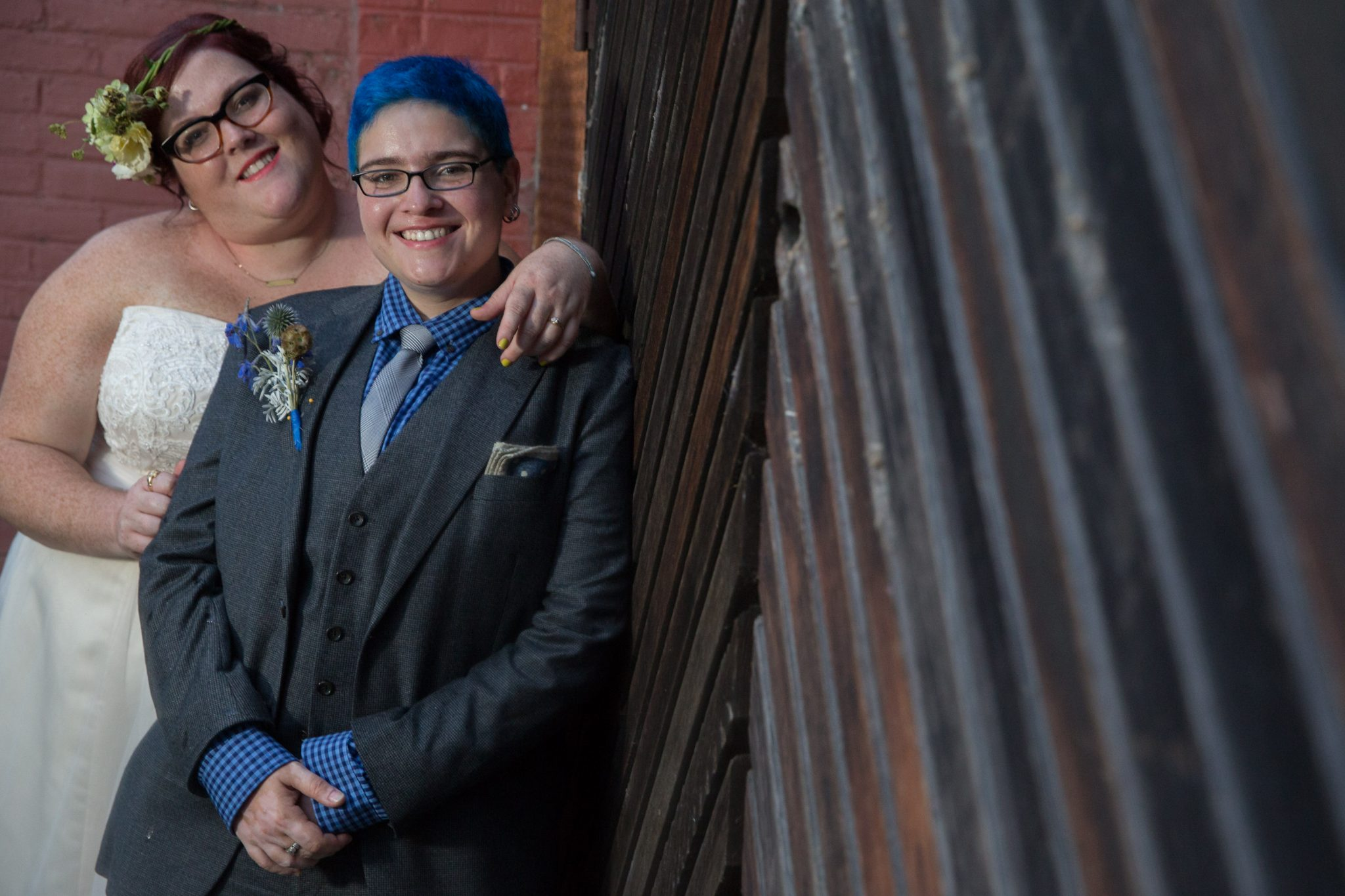 portrait of gay wedding couple featuring blue in Burlington, Vermont