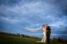 wedding portrait in the golden hour light with epic veil by Vermont Wedding photographers