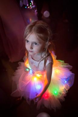 Wedding flower girl at the Inn at Grace Farm lit with lights