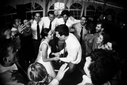 Circle of friends dancing at wedding reception at Jay Peak in Vermont