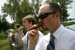 Kazoos being played while bride goes down aisle at Lake Bomoseen wedding