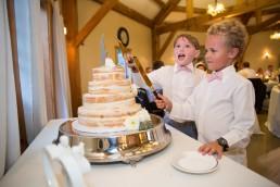kids cut wedding cake at inn at grace farm in saint albans vermont
