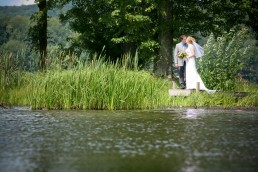 wedding couple kiss after ceremony on Lake Bomoseen in Vermont