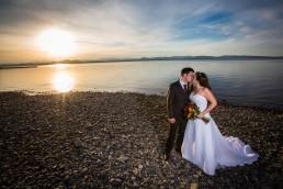 sunset wedding couple portrait on Lake Champlain in Vermont