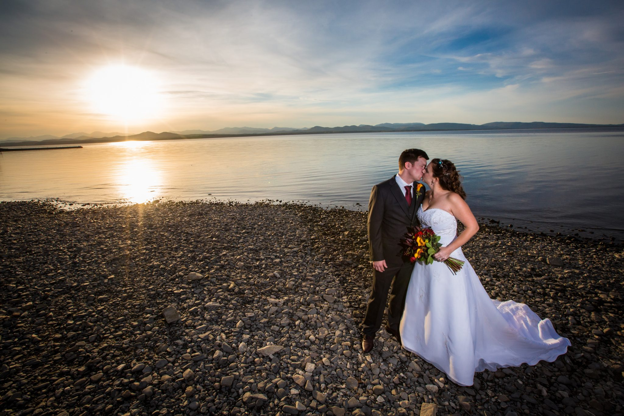 sunset wedding couple portrait on Lake Champlain in Vermont