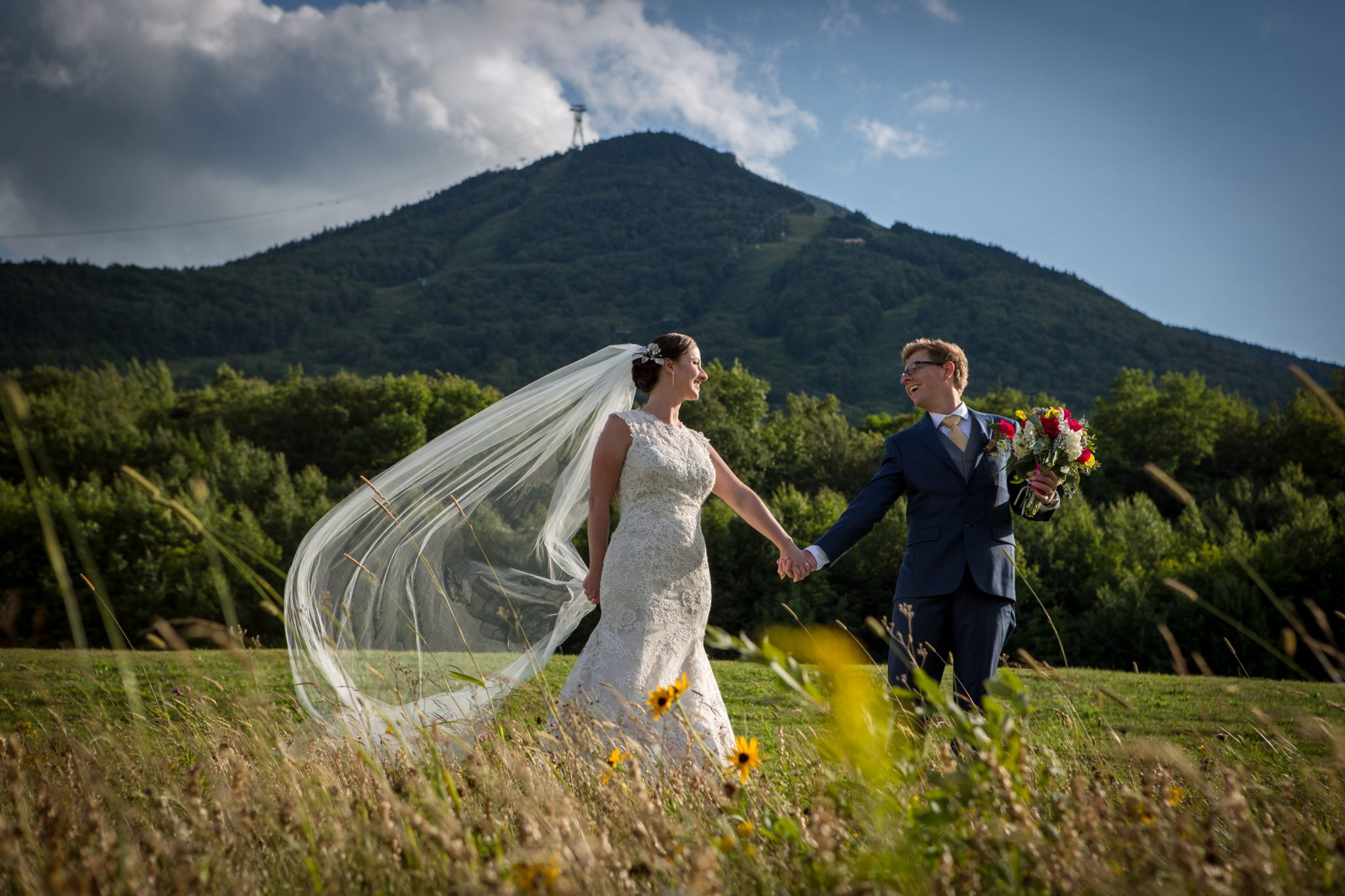 Wedding couple portrait featuring Jay Peak and epic veil in Vermont
