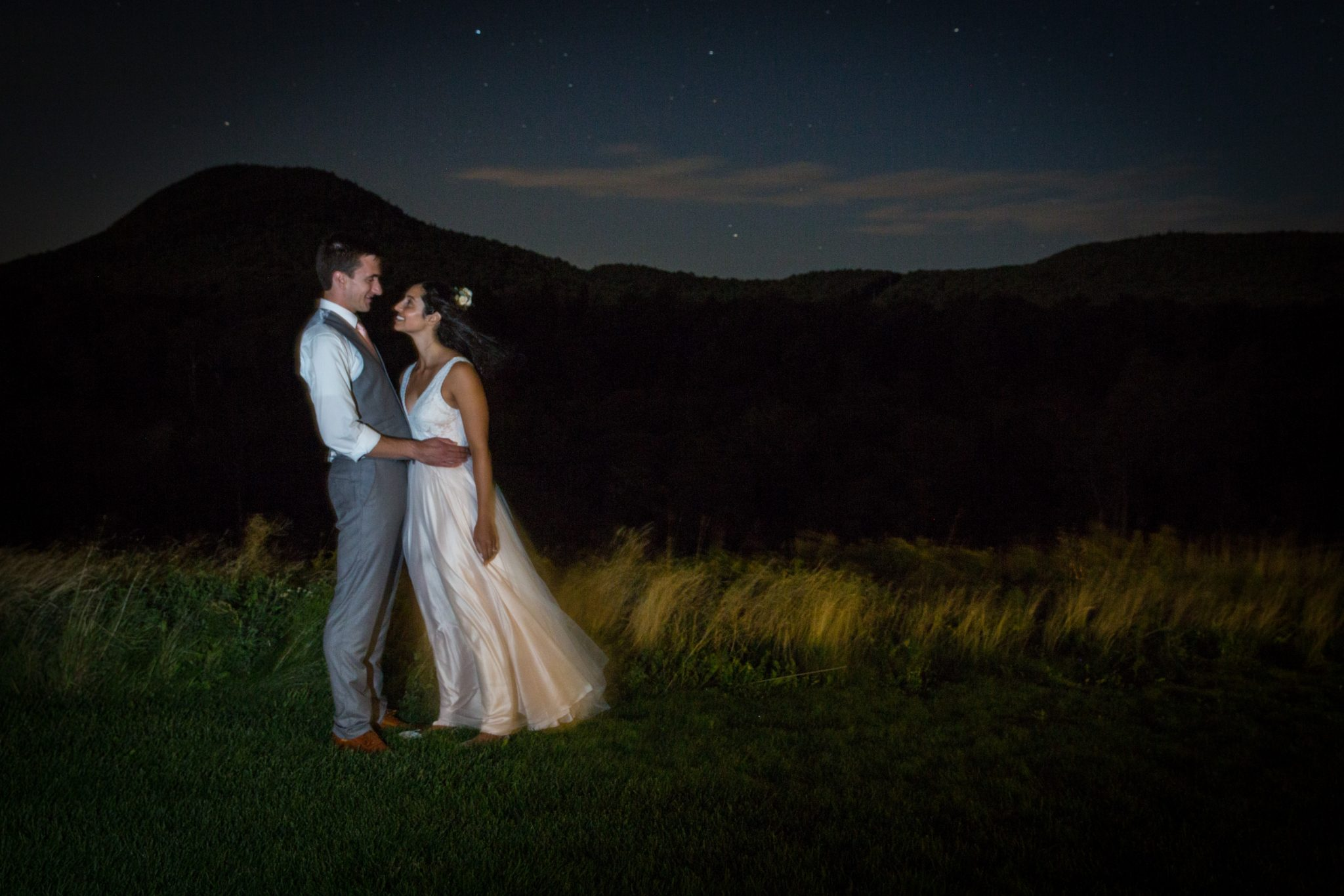 Night photograph of stars and wedding couple at Jay Peak in Vermont