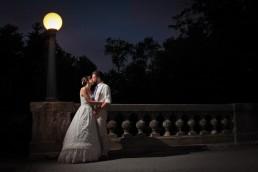 night wedding portrait under street lamp on bridge at Echo Lake Inn in Vermont