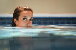 a personal branding portrait of a woman in pool in Vermont