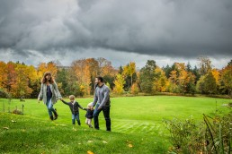 A lifestyle portrait of family walking in Vermont in fall.