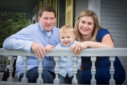 lifestyle portrait of family on porch captured in Woodstock, Vermont
