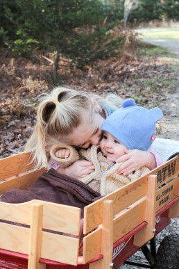 lifestyle portrait of babies in wagon captured by Vermont family photographer