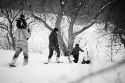 black and white lifestyle family portrait snow shoeing in Vermont