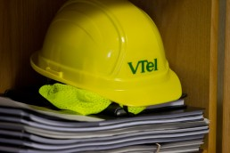 A business branding story image of construction hat in office at VTel