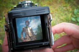 a personal branding portrait of man in vintage camera