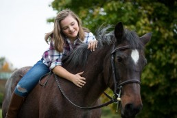 a personal branding image of a pre teen girl riding her horse