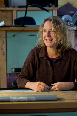 a personal branding image of a woman landscape architect at desk