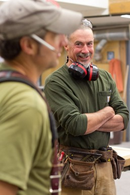 a personal branding image of two carpenters having discussion for Yestermorrow