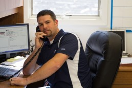personal branding image of a man working on the telephone
