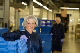 business branding image of two women posing on work floor