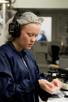 personal branding image of woman scientist with hairnet working in lab