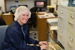 a personal branding image of a woman in hairnet with files