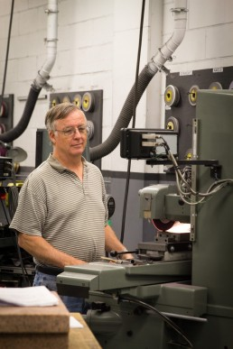 a business branding image of a machinist at machine