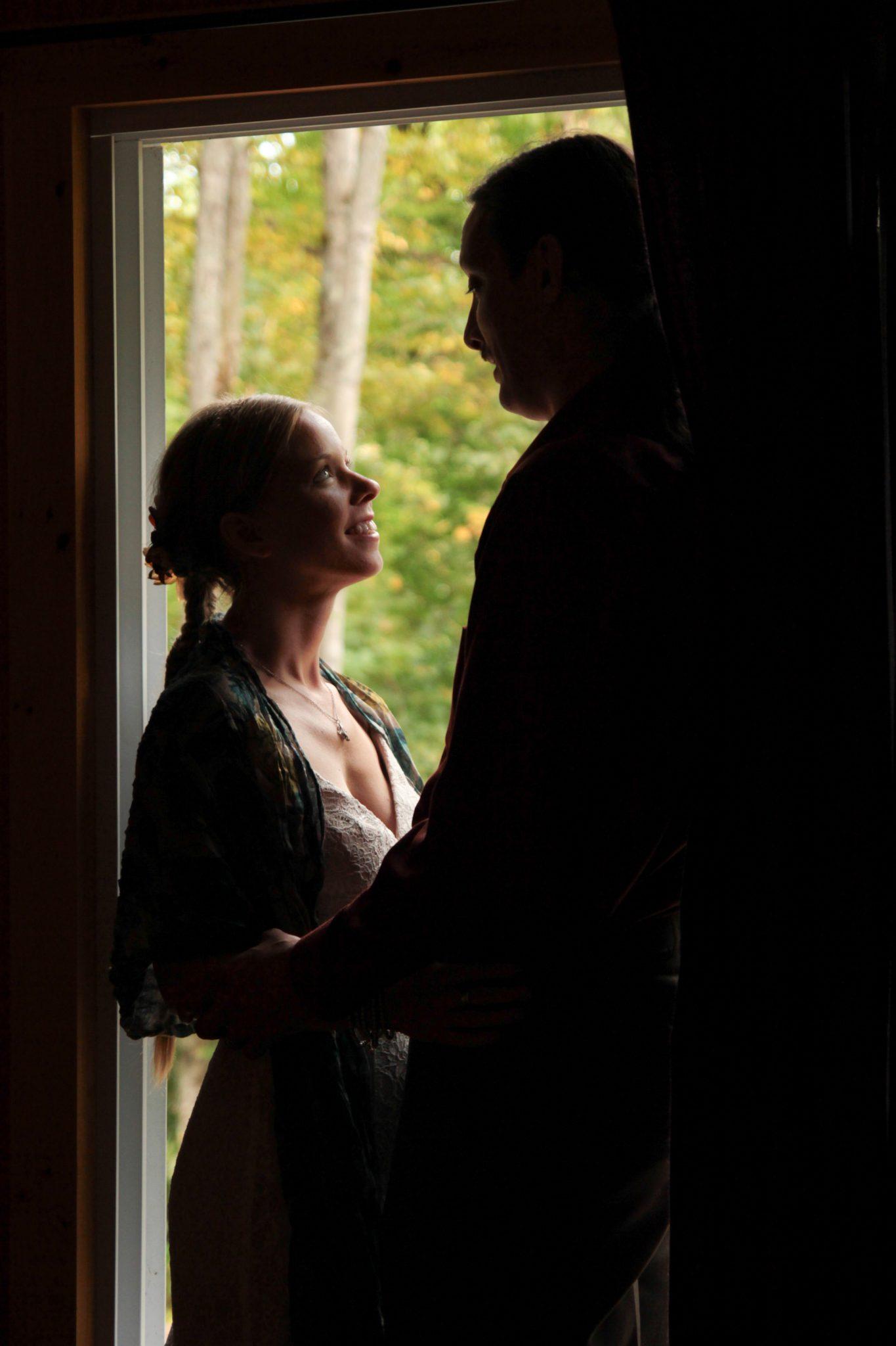 wedding portrait silhouette through light in doorway in Montpelier, Vermont