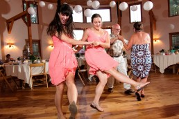 Bridesmaids dance together at wedding reception at Sleepy Hollow in Vermont