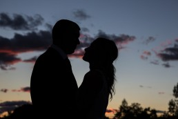 Wedding at the Essex in Vermont with couple silhouetted in sunset