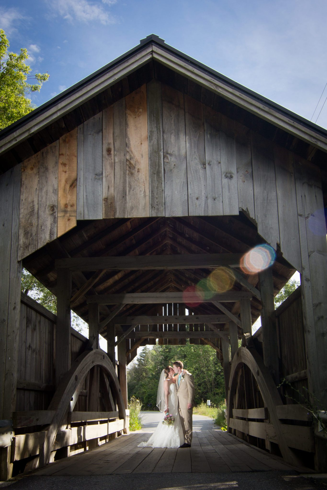 Covered bridge and wedding couple at Lake Champlain in Vermont