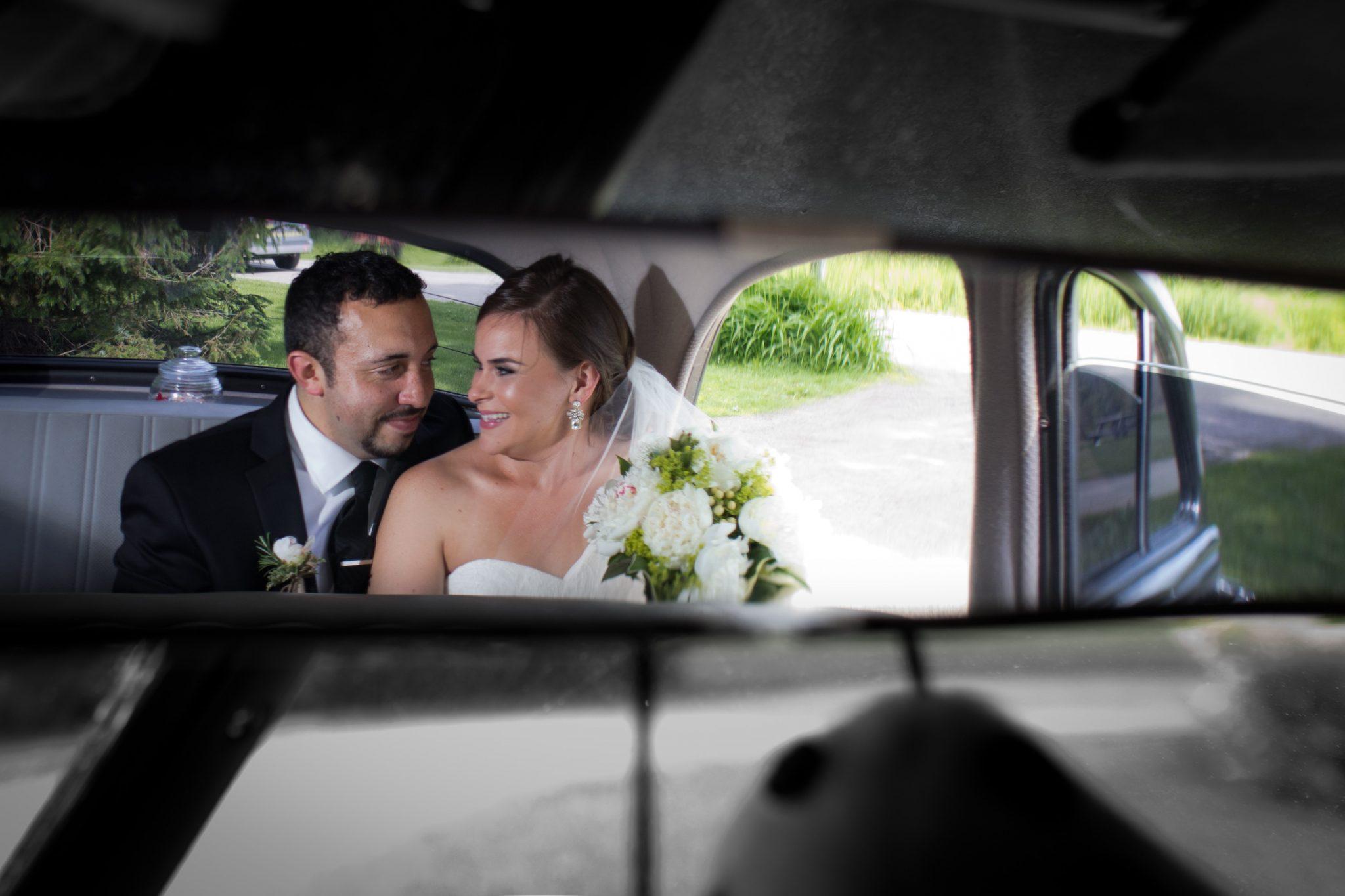 Vintage car mirror features wedding couple portrait in vermont