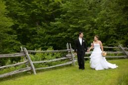wedding portrait of couple walking around The Ponds in Bolton, Vermont