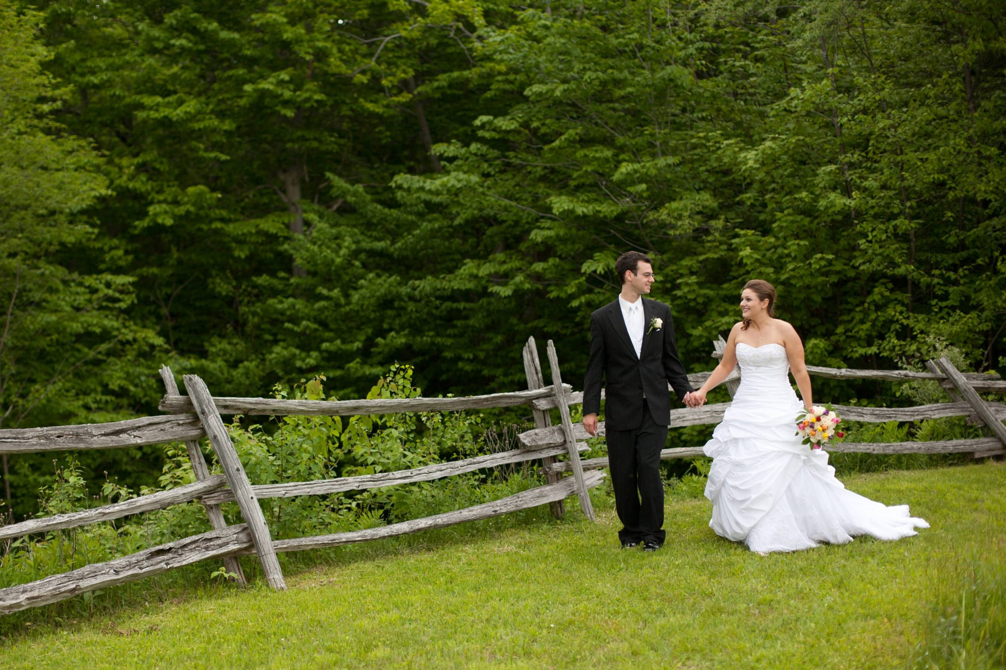 wedding portrait of couple walking around The Ponds in Bolton, Vermont