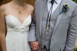 wedding details portrait with bolo and lace at Common Ground Center in Vermont
