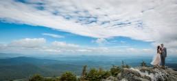 Wedding portrait featuring vast mountaintop at Jay Peak in Vermont