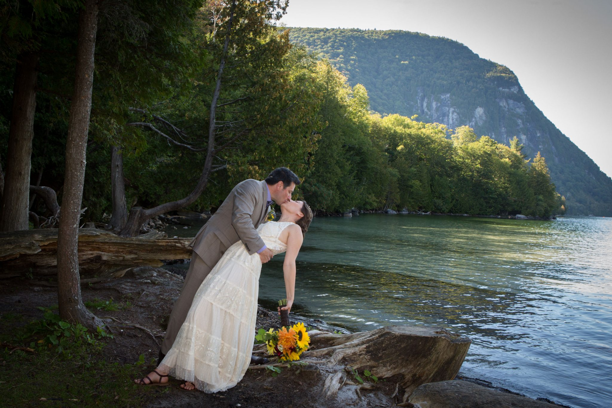 candid wedding portrait kiss at Notch House on Willoughby Lake, Westmore, Vermont