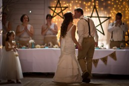 wedding reception kiss in barre vermont barn with twinkle lights