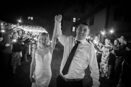 Black and white image of couple at wedding with sparklers at the Essex Resort in Vermont