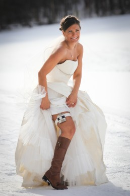 Winter bride portrait with flask in snow at Mountaintop in Chittenden