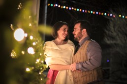 winter wedding portrait with twinkle lights at the pitcher inn in vermont